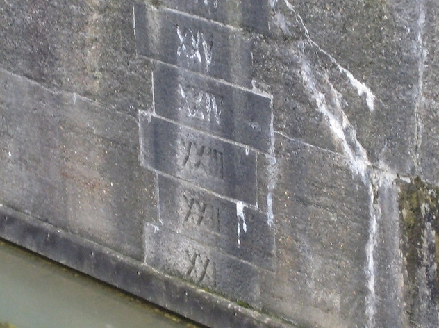 Depth markers on London Dock wall