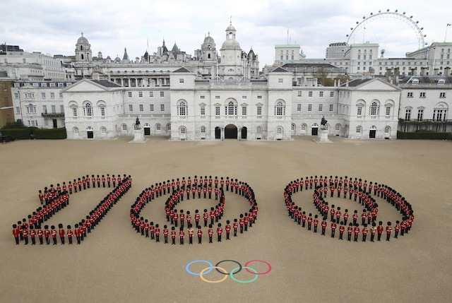 London is ready to welcome the world. At Horse Guards Parade in central London 260 Guardsmen from the Grenadier, Coldstream, Scots and Welsh Guards mark 100 days to go to the London 2012 Olympic Games.
