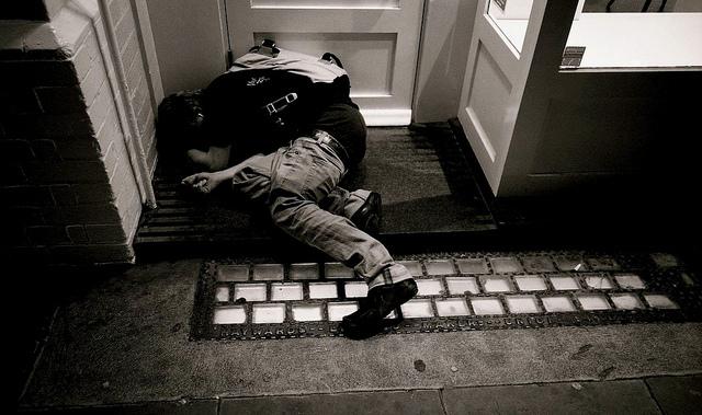 Drunk in a doorway, by dominica69