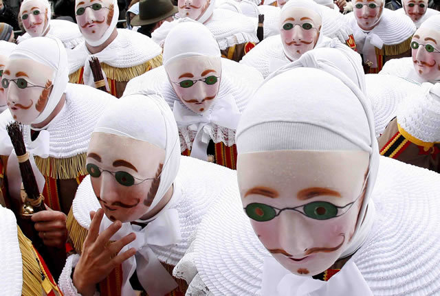 "March of the Gilles in Binche, Belgium, dating from the 14th century. Taking place around Shrove Tuesday, this is described by one website as ""the biggest and the liveliest annual event in Belgium"""