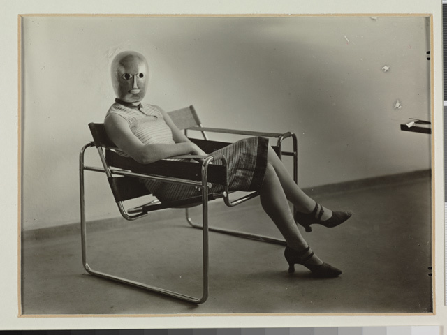 Erich Consemüller, Lis Beyer or Ise Gropius sitting on the B3 club chair by Marcel Breuer and wearing a mask by Oskar Schlemmer and dress fabric by Lis Beyer, c. 1927