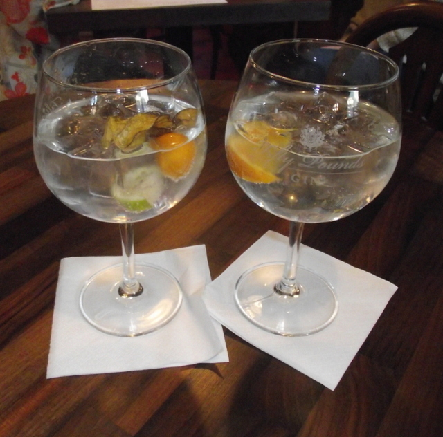 Two perfect G&Ts in balloon glasses, using different gins with individual garnish - delish