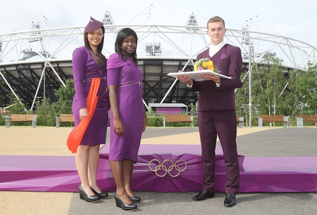 Victory Ceremonies Podiums, Ceremonial Costumes And Floral Bouquets Revealed. Pictured are Gamesmakes, Jodie Rodaway (Presenter Escort with hat), Hilda Kwafo-Akoto (Athlete Escort), Matt Smith (Medal & Flower Bearer). 