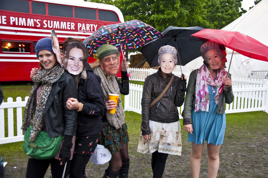 Revellers enjoy the Applecart Festival in Victoria Park, Hackney, East London in the rain.