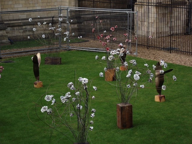 The ceramic installation of roses and tulips created by artist Paul Cummins
