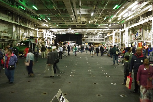 The spacious hanger deck is used to store helicopters, prepare for missions, and display equipment to visiting tourists.