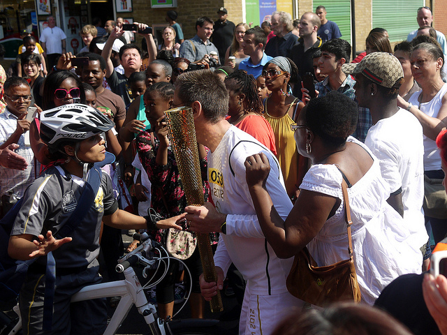 The next torch bearer gets his instructions amid huge excitement on Great Dover Street SE1 yesterday by Paul Wood