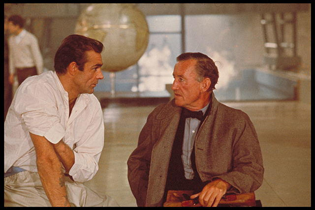 "Sean Connery and author Ian Fleming discuss the character of James Bond while filming an interior scene for ""Dr No"" at Pinewood Studios. Copyright Notice - © 1962 Danjaq, LLC and United Artists Corporation. All rights reserved"