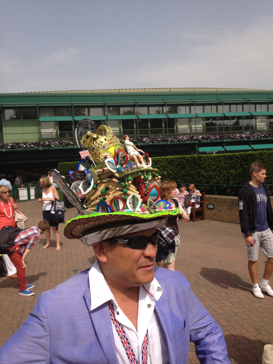 The self-titled 'Hatman of London' with his latest tennis-themed headpiece