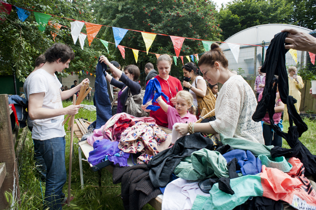 Choosing the outfits for the scarecrows.
