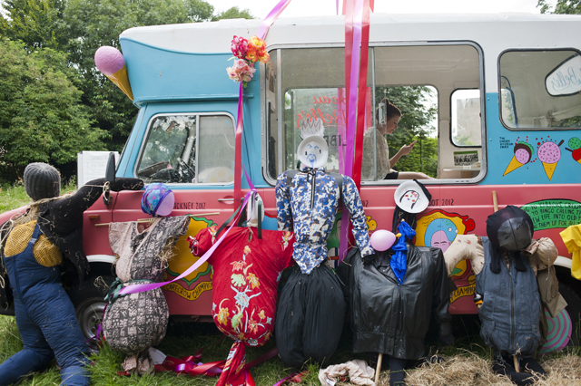 The scarecrows and the van.