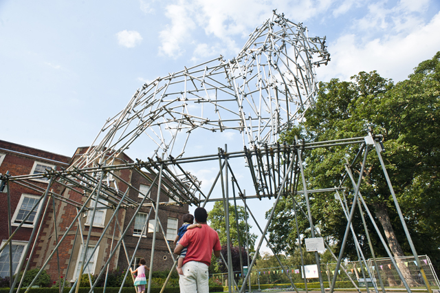 Interacting with the Lion scaffolding sculpture
