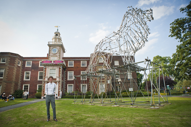Ben Long, the artist, with the Lion scaffolding sculpture