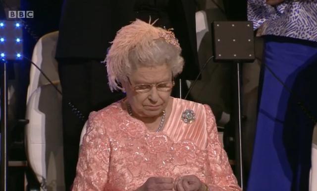 Queenie checks her nails.
