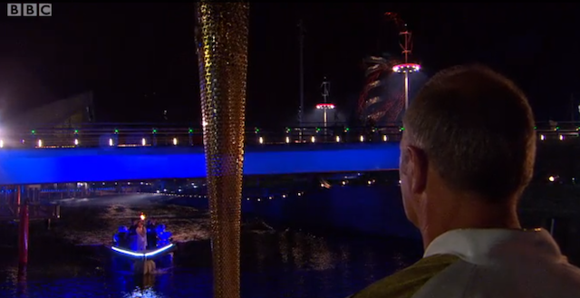 Sir Steve Redgrave awaits the Olympic flame, which seemed to get lost on Bow Back Rivers.