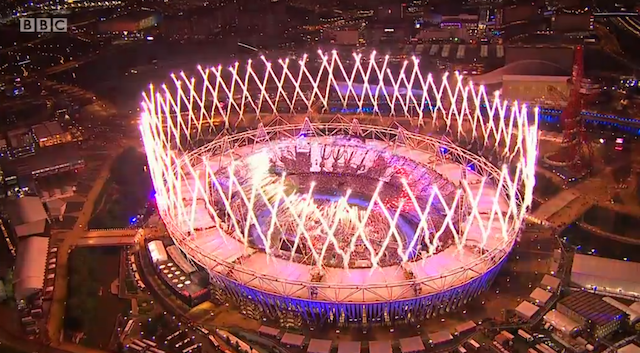 The stadium structure grows in fireworks.