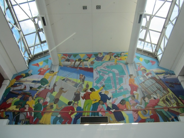 Unusually, Tesco commissioned and paid for two large murals inside Surrey Quays shopping centre. They're from Greenwich Mural Workshops and include work by Brian Barnes and others.