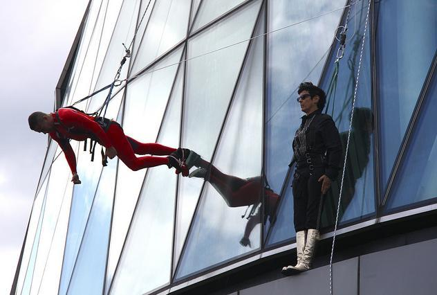 Elizabeth Streb (in black) pauses during the City Hall performance / photo by MykReeve