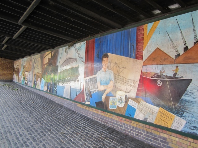 The dockers' shelter mural in Surrey Quays. Made in the 1990s by Bermondsey Art Group, it tells a chronological history of the former docks.