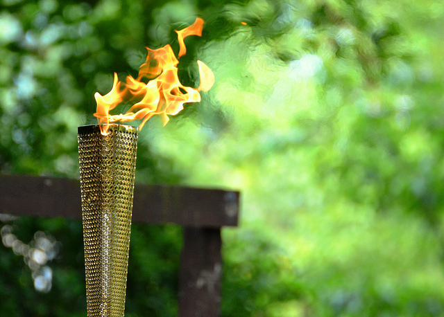 The torch in flame at Barking Park / photo by Pallab Seth