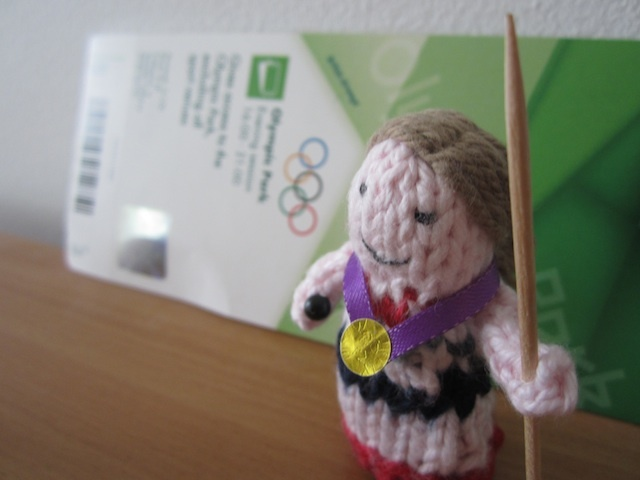Heptathlete Jessica Ennis poses with her cocktail stick javelin.