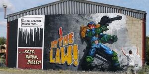 Judge Dredd Mural Greets Heathrow Arrivals With A Massive Gun