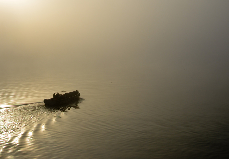 A boat moves along the River Thames and into a wall of fog, November 2011.