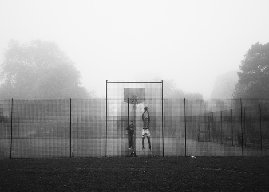 Two men play basketball on a foggy morning. Dulwich Park, October 2012