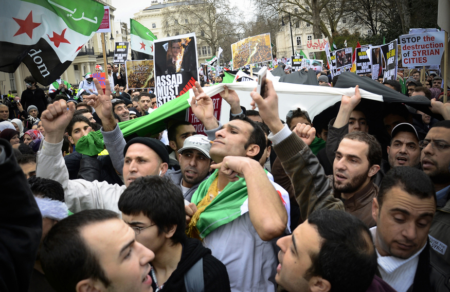Syrian protesters gather outside the Syrian Embassy, London, March 2012