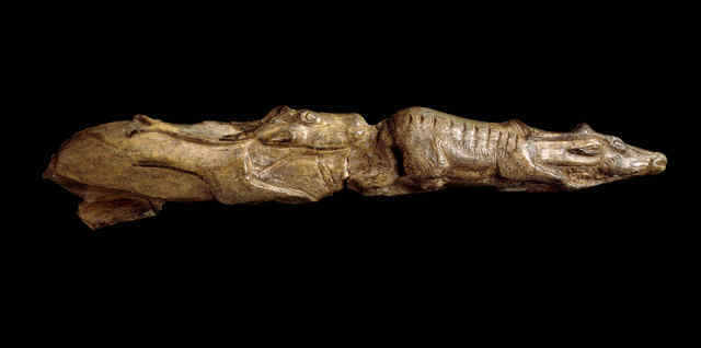 33738: Tip of a mammoth tusk carved as two reindeer depicted one behind the other; 13,000 years old approximately; Montastruc, France; Copyright of The Trustees of the British Museum