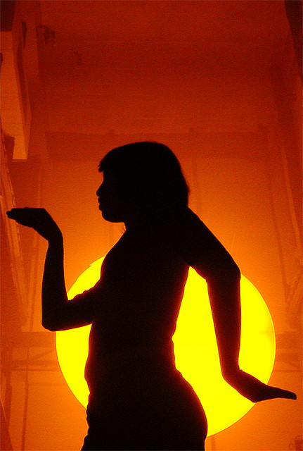 A visitor to Olafur Eliason's Sun installation in Tate Modern, 2003, walks like an Egyptian. Photo by Taro Taylor.