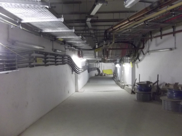 Not the best photo, but a rarely seen service tunnel beneath King's Cross station. Photo by M@.