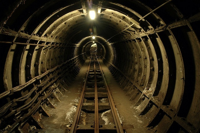 The now defunct MailRail tunnels, which used to carry Royal Mail letters and packages beneath the capital. Photographed on a tour by David Warwick in 2006.