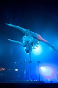 Contortionist Henna Kaikula balances over broken glass in circus show Cantina.