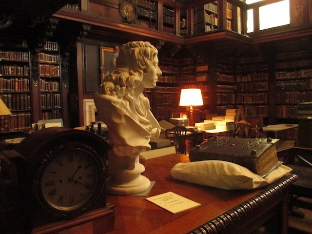 Inside the library, including a bust of the young Christopher Wren.