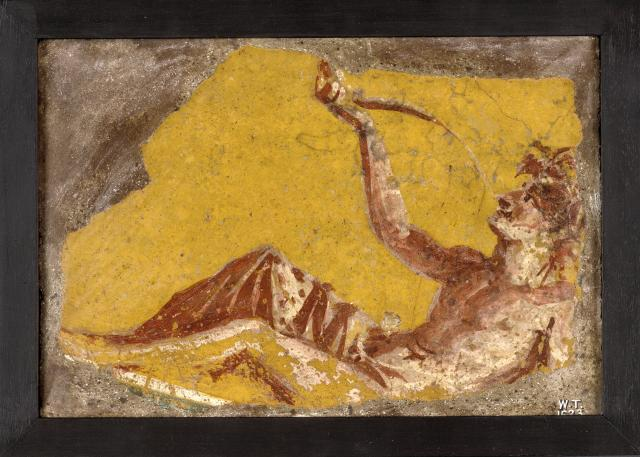 Fragment of a wall painting showing a man reclining to drink. From Pompeii, 1st century AD. Copyright the Trustees of the British Museum