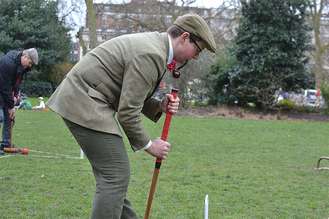 Croquet is a serious game, but not so much that it should interrupt smoking.