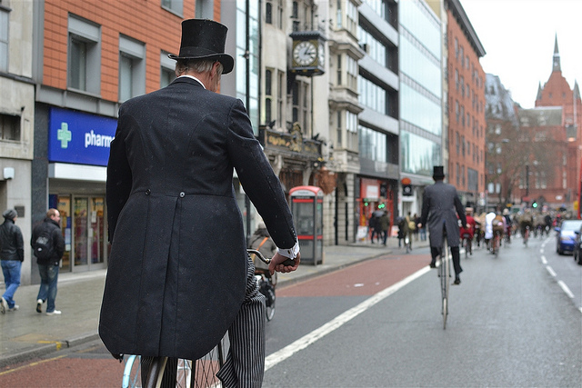 Two penny farthings heading towards Chancery Lane station in the rain (which had just started to spit).