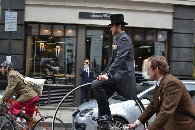 First sighting of a penny farthing out on the road. This time rolling past a tailors.