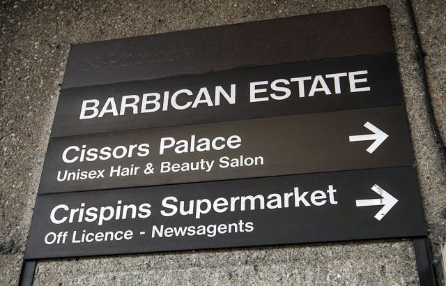 A sign on the estate. Crispin's Supermarket is no longer in business, nor is Pinxtos, whose name can just be made out in the top slot.