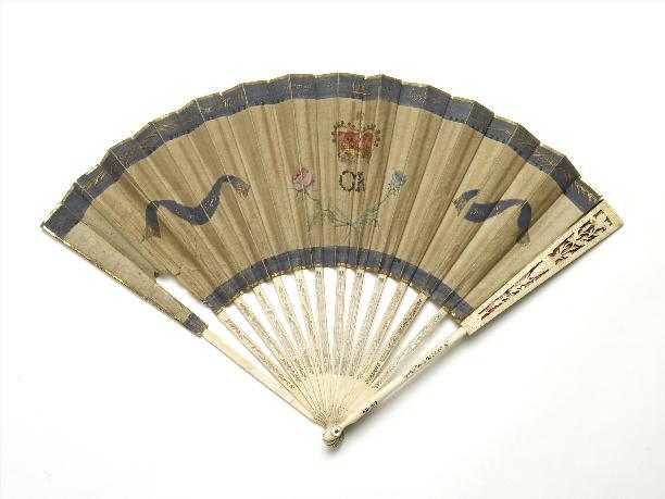 This unusual commemorative fan links the well-being of the nation with the health of the King with the phrase 'Health is restored to ONE and happiness to millions.' George III had recovered from one of his recurring bouts of illness and the fan was issued as part of efforts to re-establish his authority. On the King's Happy Recovery. 1789. Loan courtesy of the Museum of London