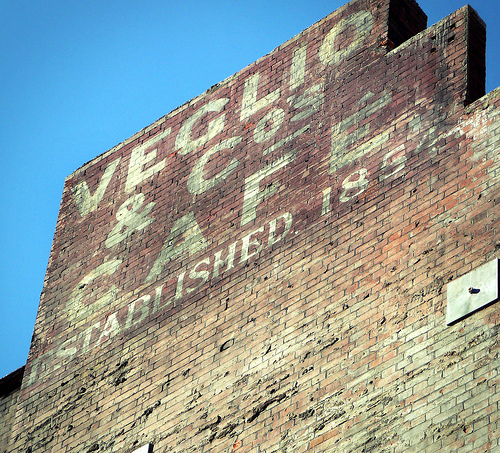 Veglio & Co cafe. This sign above Tottenham Court Road station was revealed after being hidden for many years during the Crossrail works. Photo by buckaroo kid