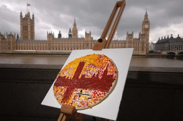 "A 'MASTER PIZZA' CREATED  BY FOOD ARTIST PRUDENCE STAITE FOR PIZZA EXPRESS. Vincent Van Gogh�s Sunflowers returned to the UK today, but with a tasty twist on the original painting. While Van Gogh�s masterpiece is spending the summer in Amsterdam rather than its usual home in London, PizzaExpress brought a bit of colour to a grey summer by turning the artwork into a master-pizza, and returning it the gallery (The National Gallery) that normally houses it.  THE PIZZA CHAIN HAS COMMISSIONED Works by Van Gogh, Monet, Warhol, Munch and Lichtenstein have all been transformed into edible art to create a collection of master-pizzas entitled �Love Your Summer�. The mouth-watering displays mark the launch of a new initiative by PizzaExpress aimed at helping Brits make the most of the season with a special summer pass for food, art, music and film.     17.6.2013  **MANDATORY CREDIT LONDON MEDIA** ©London Media Press Ltd 11a Printing House Yard London E2 7PR 0207 613 2548   *** Local Caption *** ALL MATERIAL MUST BE CREDITED ""LONDON MEDIA"". 100% SURCHARGE IF NOT CREDITED"
