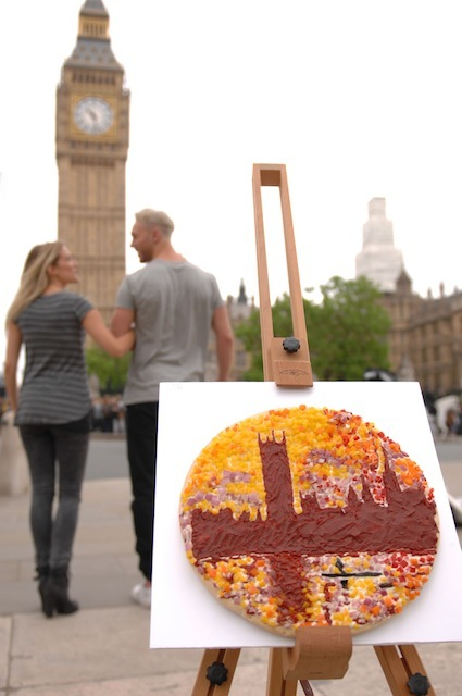 "A 'MASTER PIZZA' CREATED  BY FOOD ARTIST PRUDENCE STAITE FOR PIZZA EXPRESS. As well as the return of Sunflowers, passers-by on The South Bank were today treated to a tasty pop-up exhibition of Monet�s famous portrayal of Big Ben and the Houses of Parliament, painted 110 years ago and entitled The Houses of Parliament, Sunset.    THE PIZZA CHAIN HAS COMMISSIONED Works by Van Gogh, Monet, Warhol, Munch and Lichtenstein have all been transformed into edible art to create a collection of master-pizzas entitled �Love Your Summer�. The mouth-watering displays mark the launch of a new initiative by PizzaExpress aimed at helping Brits make the most of the season with a special summer pass for food, art, music and film.     17.6.2013  **MANDATORY CREDIT LONDON MEDIA** ©London Media Press Ltd 11a Printing House Yard London E2 7PR 0207 613 2548   *** Local Caption *** ALL MATERIAL MUST BE CREDITED ""LONDON MEDIA"". 100% SURCHARGE IF NOT CREDITED"