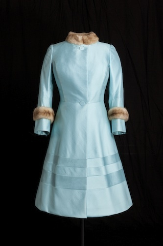 This brightly-coloured, short, A-line dress and jacket, worn by The Queen in 1972, is in keeping with fashions of the time. Its simple, single-colour design ensures The Queen is visible in large crowds. Royal Collection Trust © Her Majesty Queen Elizabeth II 2013. Image Historic Royal Palaces / Robin Forster