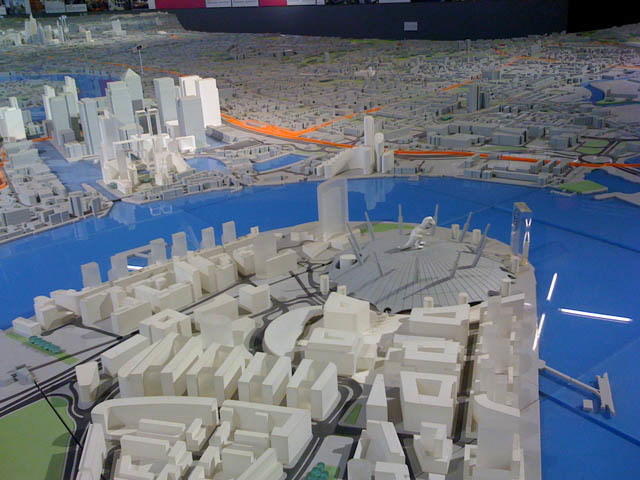 NEW LONDON ARCHITECTURE: This vast and detailed model shows London from Battersea to the Royal Docks, at a scale of 1:1500. It's updated regularly to highlight newly planned buildings. It's also occasionally augmented by cheeky interventions from the public, such as the dinosaur you might just be able to make out on top of the O2 dome. You can access it free of charge, any day of the week except Sunday, at 26 Store Street (off Tottenham Court Road). Just walk in. The model even includes a tiny model of 26 Store Street, leading to the conundrum of whether that model itself contains a model, and so on into Mandelbrotian depths.