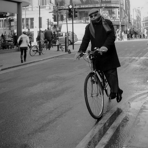 Riding a bicycle with distinction by Ian Brumpton