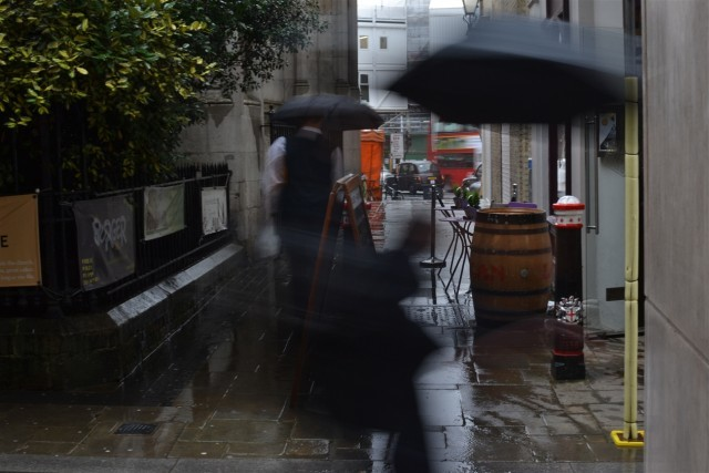 Rainy alleyway lunchtime rush