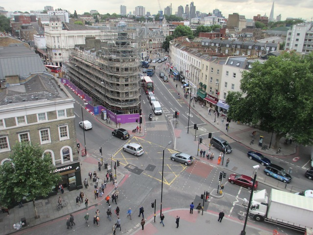 A view of the notorious King's Cross road junction, and the 'lighthouse block', itself undergoing redevelopment.