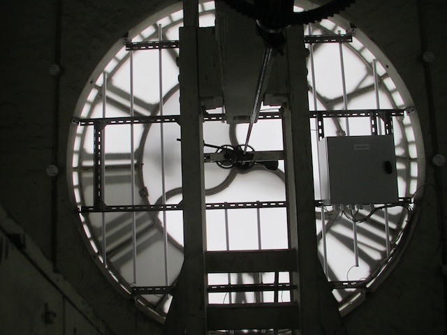Behind the clock face.